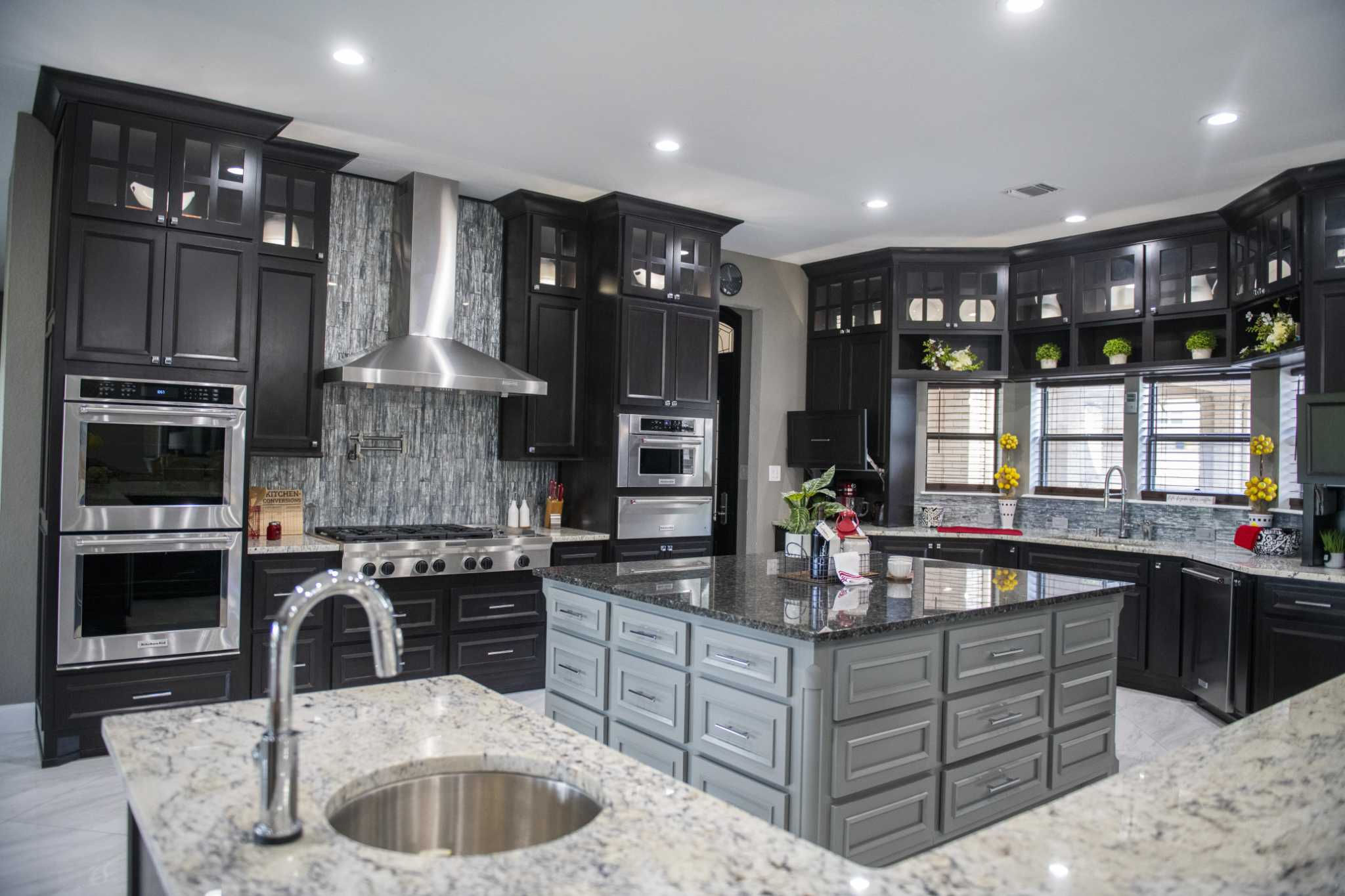 Greg and Vanessa Douglas incorporated some of the latest trends in kitchen cabinets when they renovated their kitchen in their home in Garden Ridge.